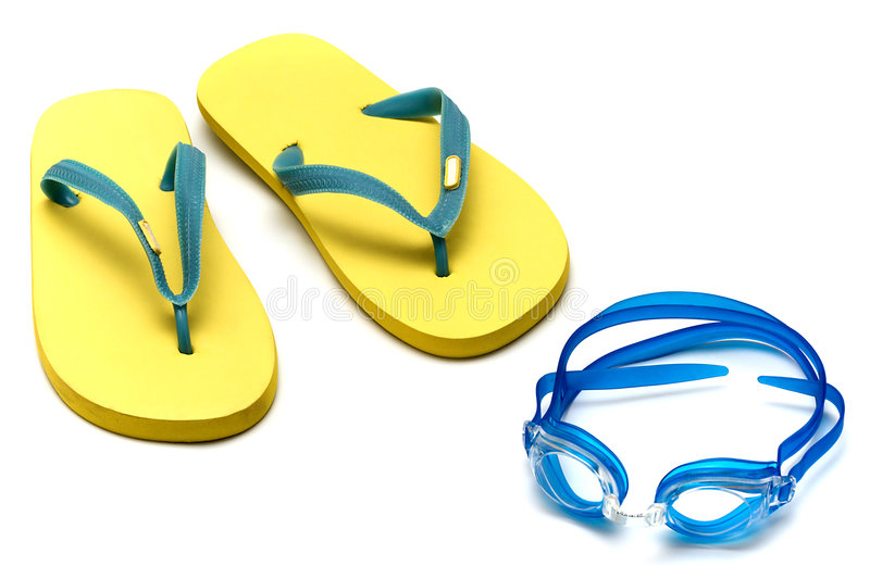 Sandals and goggles. Sandals and glasses for swimming on the white stock photo