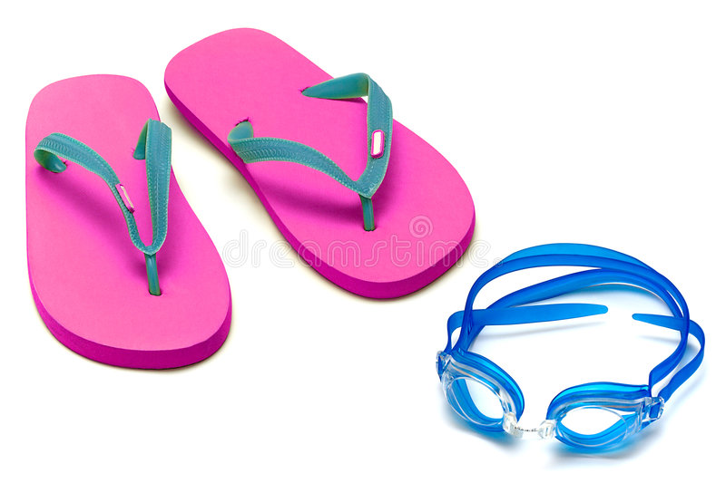 Sandals and goggles. Sandals and glasses for swimming on the white royalty free stock image
