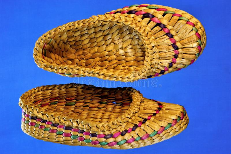 Sandals manual weaving, made of natural material, made by skilled craftsmen in the best traditions of the old crafts from the. Natural material. Feet in this stock photos