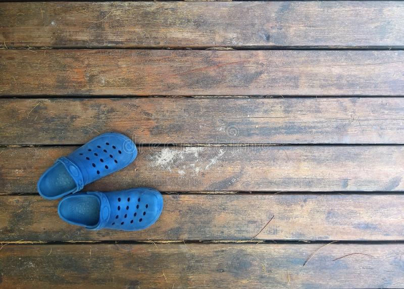Sandals over a wooden dock in summer royalty free stock photo