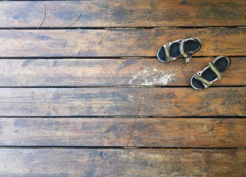 Sandals over a wooden dock in summer stock photos