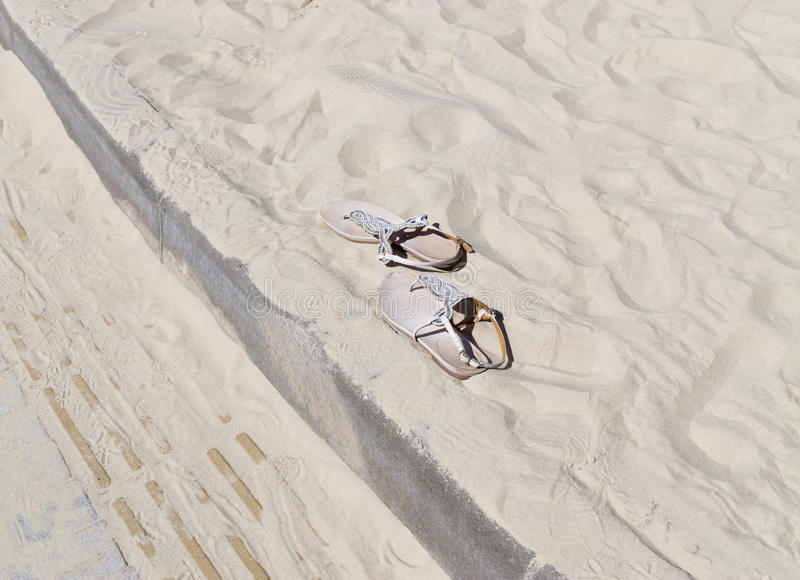 Sandals on sand royalty free stock image