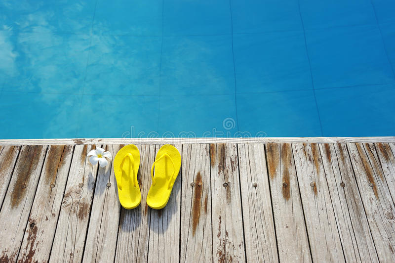 Download Sandals by a swimming pool stock photo. Image of pool - 17669322