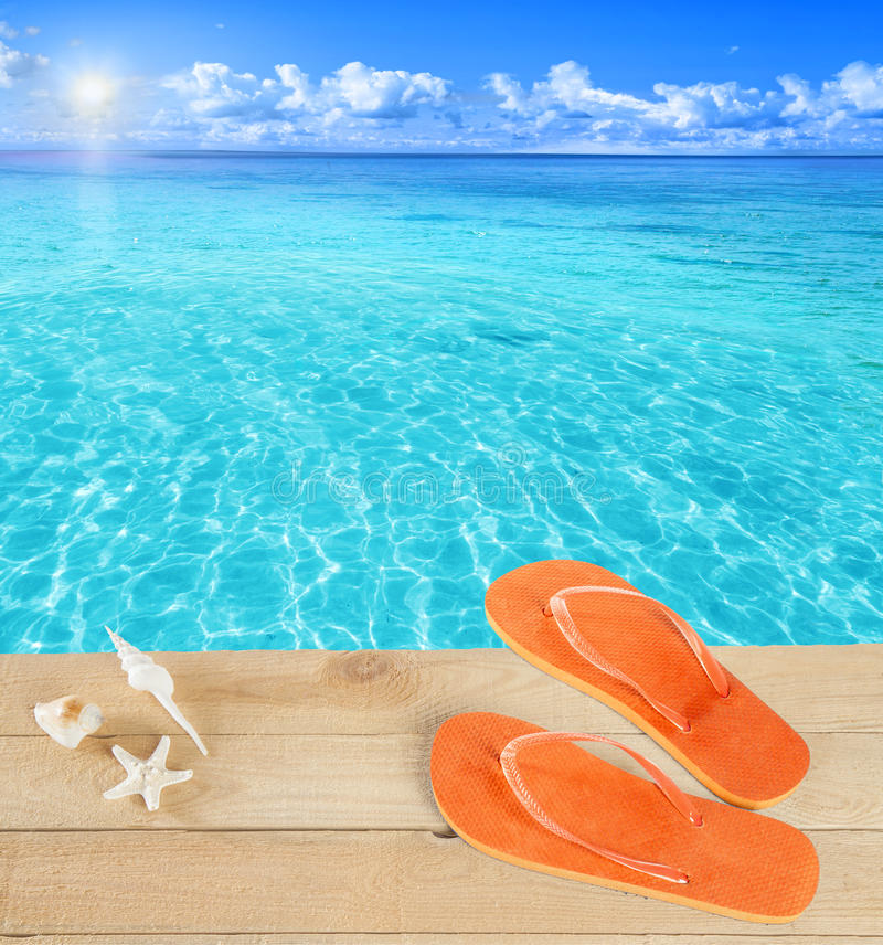 Sandals by a tropical pool stock images