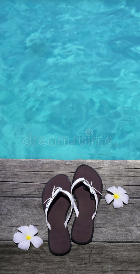 Sandals on a wooden floor stock photography