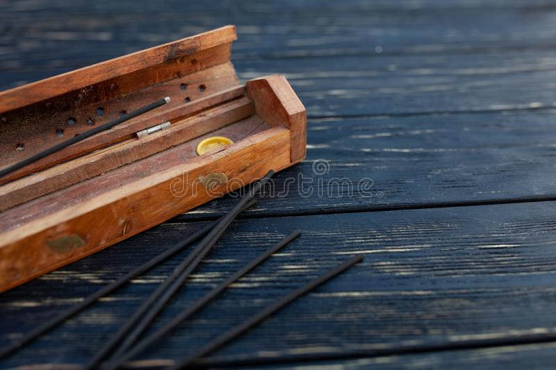Sandalwood sticks on a black wooden table. Traditional Asian culture. Aromatherapy. With free space for text royalty free stock photography