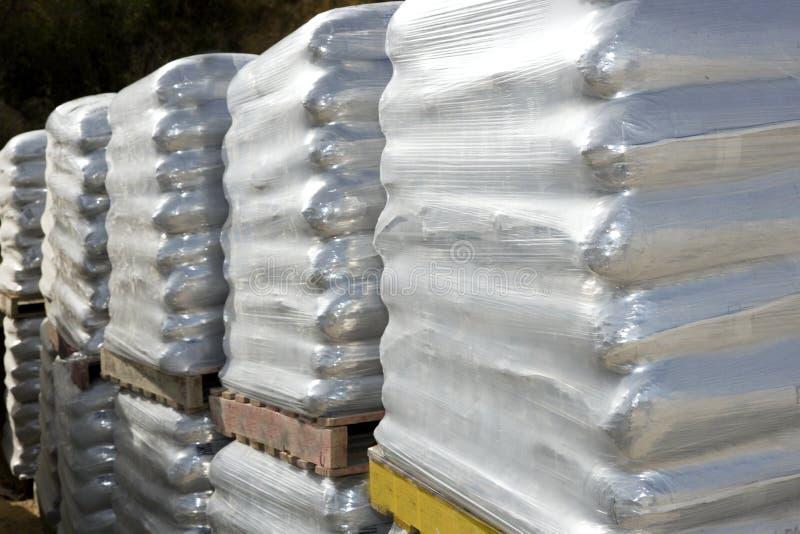 Sandbags bags white pallet sacks stacked stock images