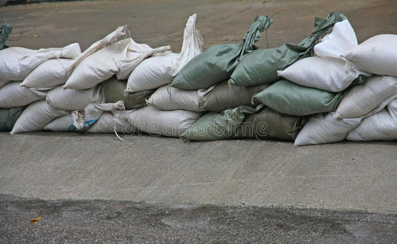 Sandbags to protect against flooding of the River during the flo. Od on the road stock image