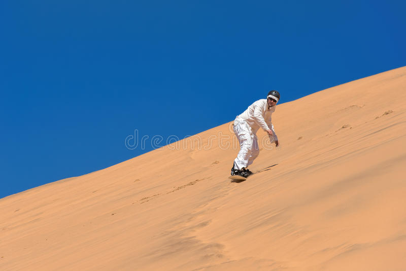 Sandboarding lizenzfreie stockfotografie