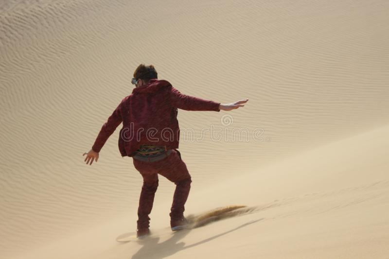 Sandboarding in the Faiyum desert stock photo