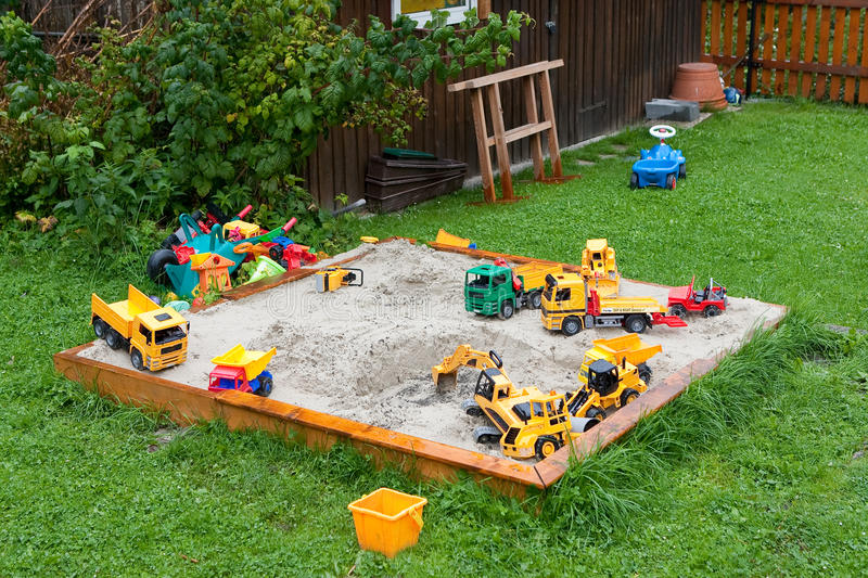 Sandbox and toys. Children have left their toys within the sandbox stock photography