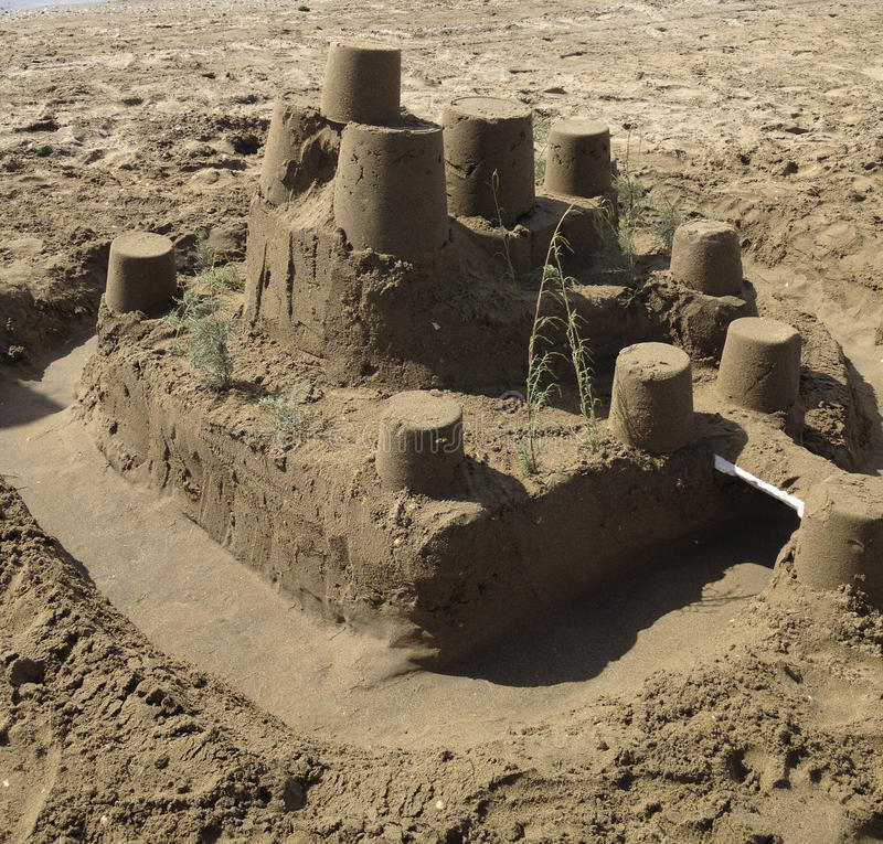 Sandcastle on the beach. The sandcastle created by children on the beach in the holiday royalty free stock photos
