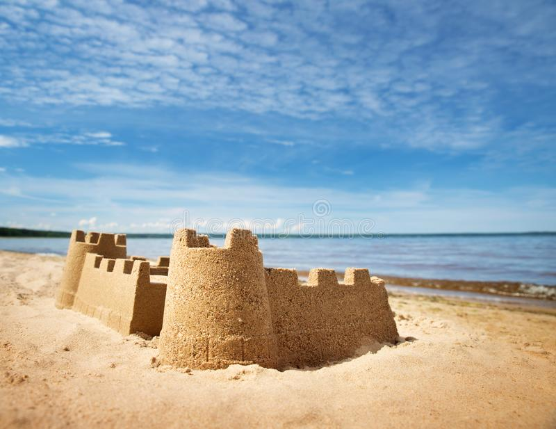 Sandcastle on the sea in summertime royalty free stock photos