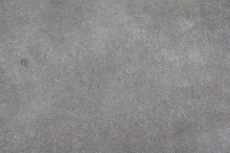 Sanded cement background. Smooth concrete surface. Polished grey stone texture.  royalty free stock images