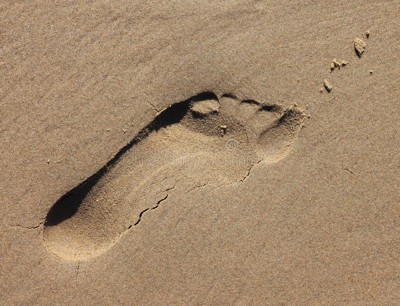 Sandfotspårintryck fotografering för bildbyråer