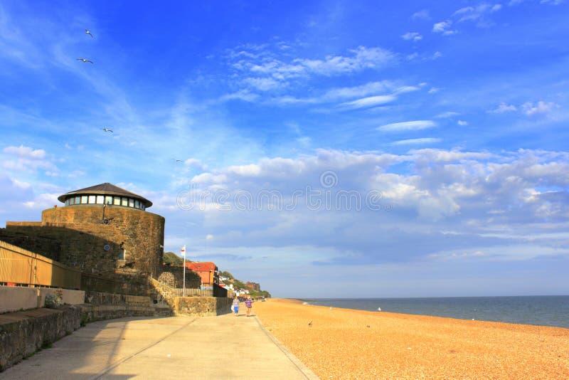Sandgate beach Folkestone Kent UK. Sandgate beach promenade with Sandgate Castle against nice blue summer sky Folkestone Kent England UK.Sandgate Castle is an royalty free stock image