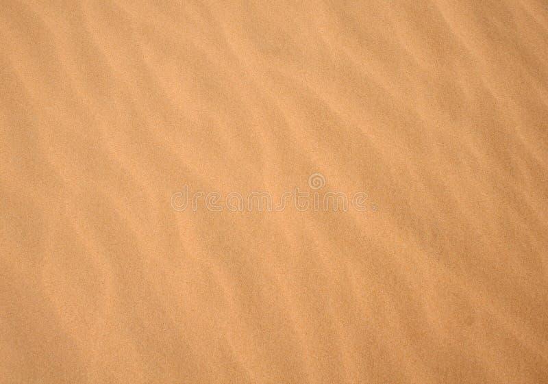 Sandhintergrundbeschaffenheit stockbild