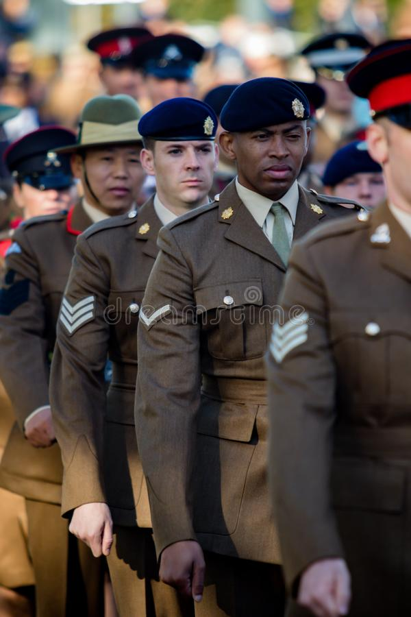 Sandhurst Remembrance 2018. Sandhurst, United Kingdom, 11th November 2018:- British Soldiers march to Sandhurst War Memorial on the 100th Anniversary of the stock photos
