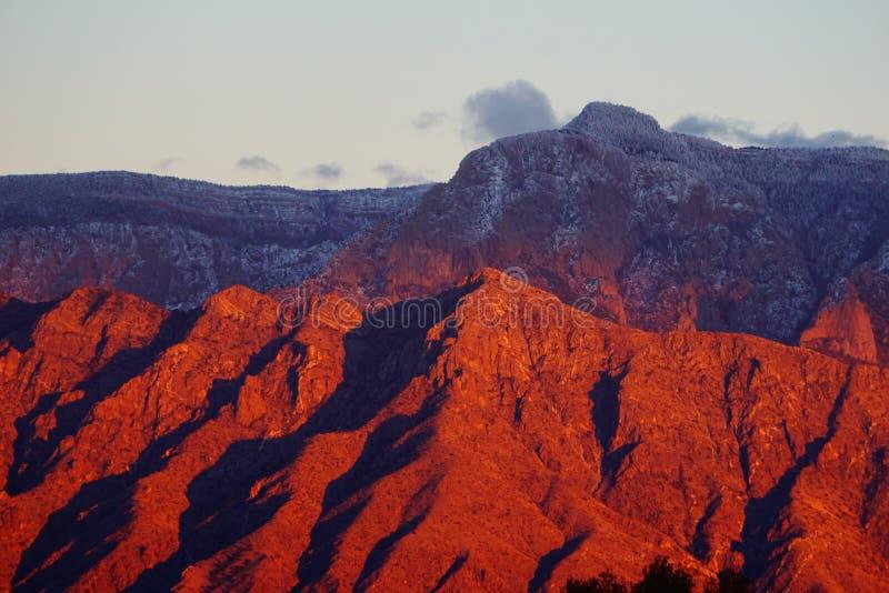 The Sandia mountains sunset with snow stock photos