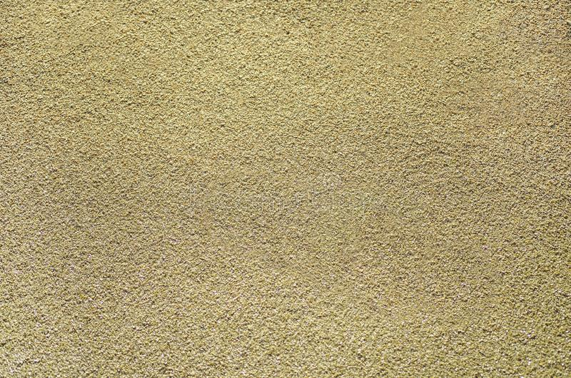 Sandig textur av beige sand arkivfoto