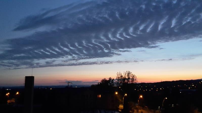 Sandiga moln fotografering för bildbyråer