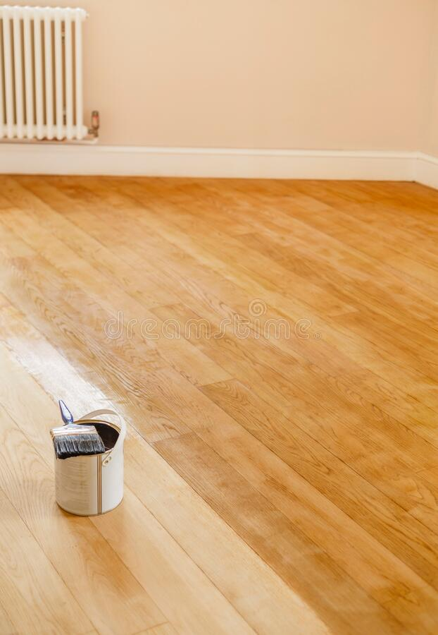 Sanding and staining a wooden floor, UK royalty free stock photos