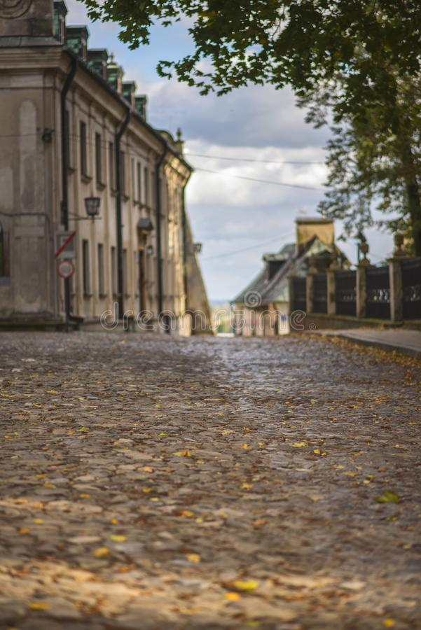 Sandomierz cobblestone street in the city poland royalty free stock photography