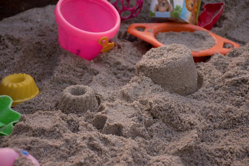 A sandpit with the children`s toys stock photo