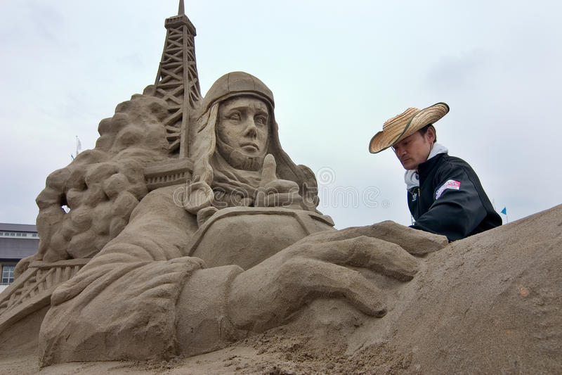 Sandsculpture artists working on his sculpture stock photos