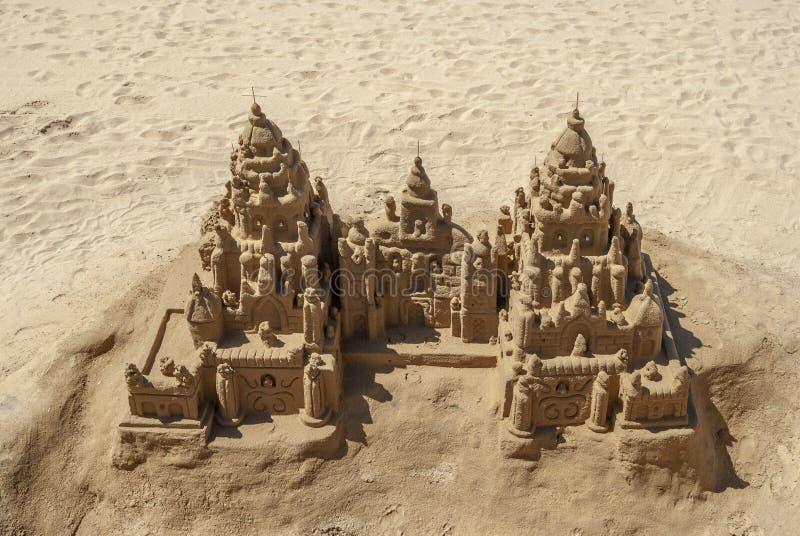 Sandslott på stranden arkivfoto