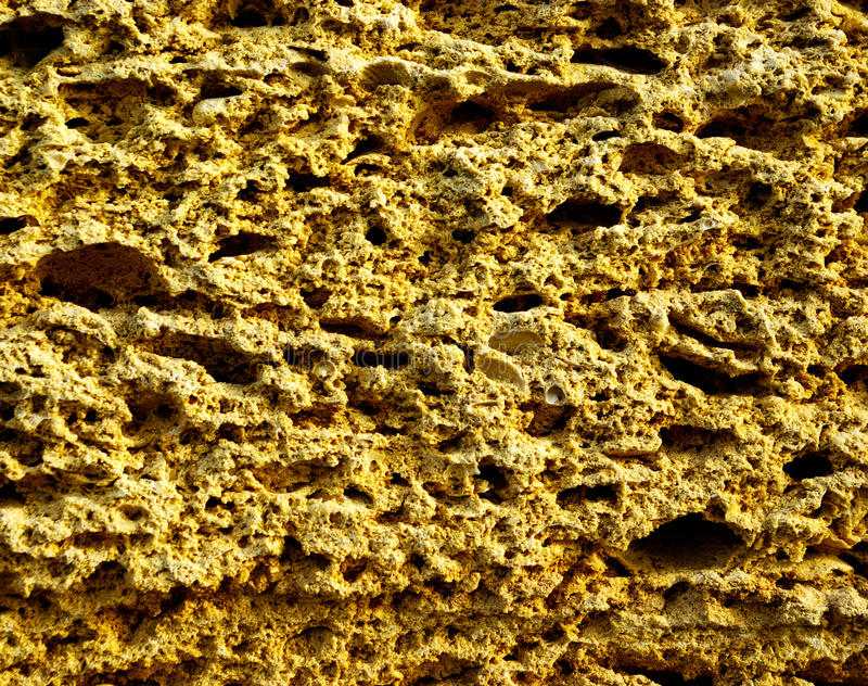 Sandstone. The stone wall from sandstone royalty free stock photo