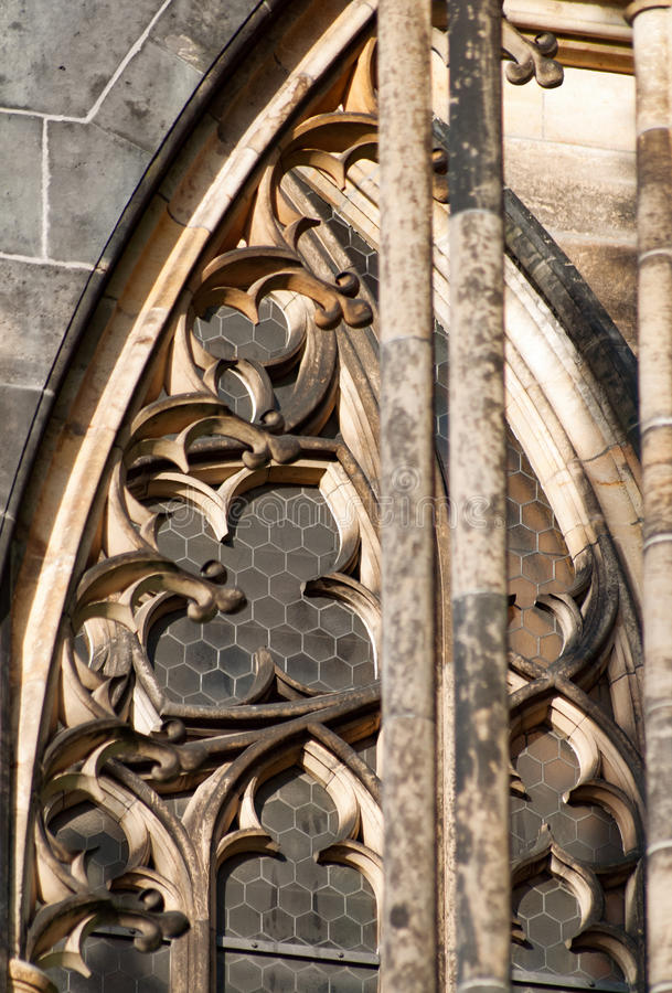 Sandstone arch windows of gothical church royalty free stock photography