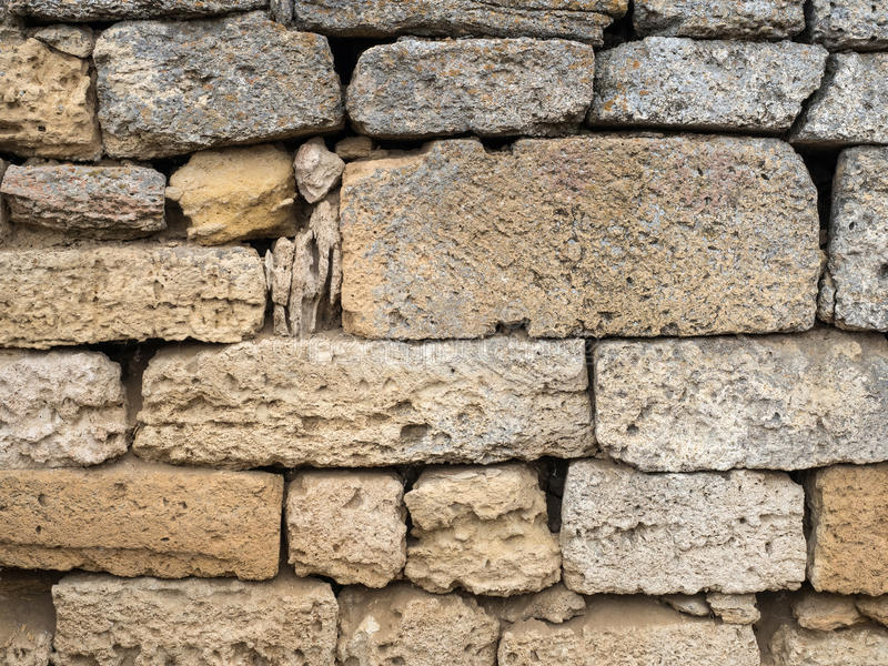 Sandstone brick wall royalty free stock image
