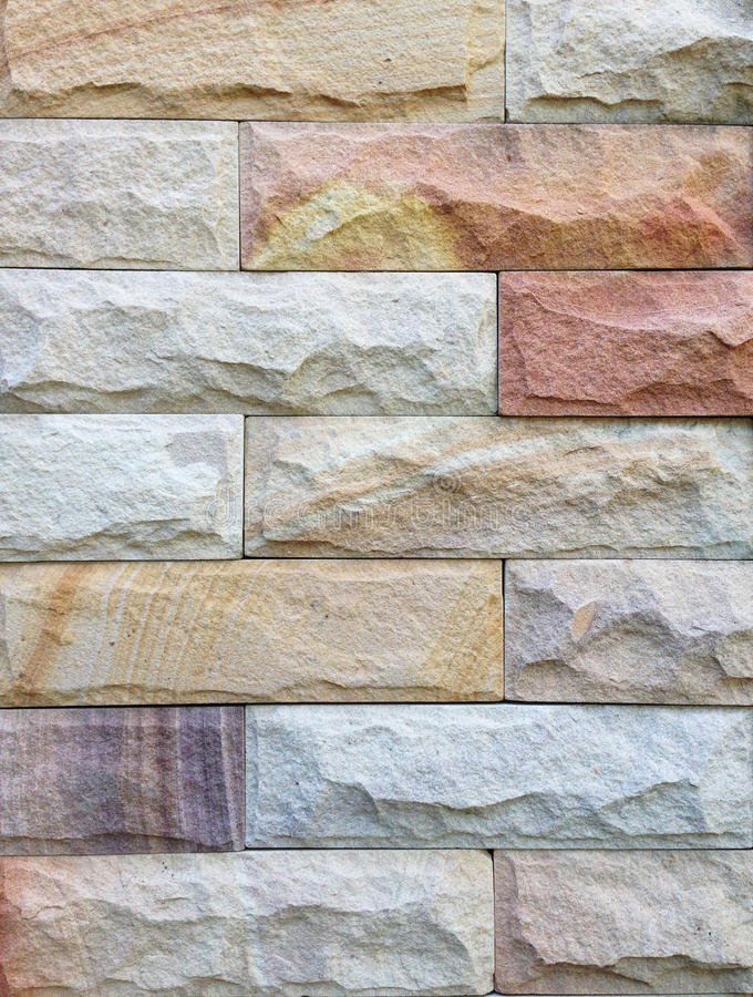 Sandstone brick wall pattern and background texture stock photography