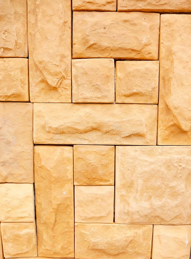 Sandstone brick wall pattern and background texture stock images