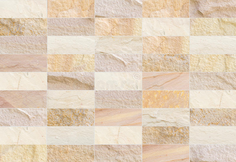 Sandstone brick wall patterned (natural patterns) texture background. royalty free stock photography