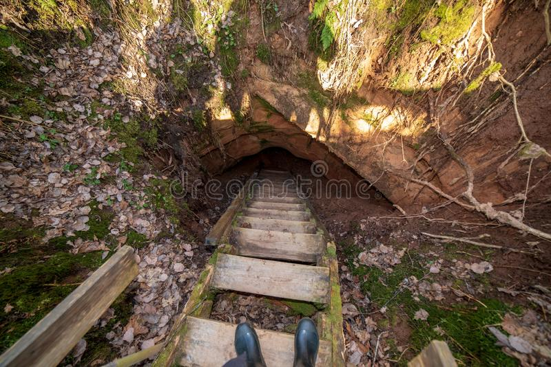 Sandstone cave with underground water flow. Abstract archeology stock images