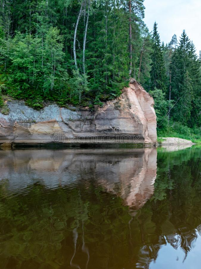 Sandstone cliffs in the evening light. Cliff and tree reflections, Erg royalty free stock photography