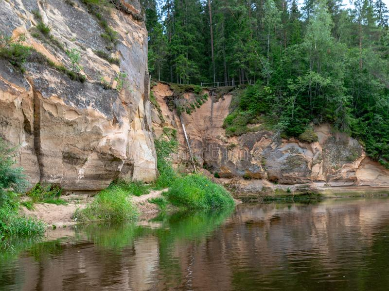 Sandstone cliffs in the evening light. Cliff and tree reflections, Erg stock photo