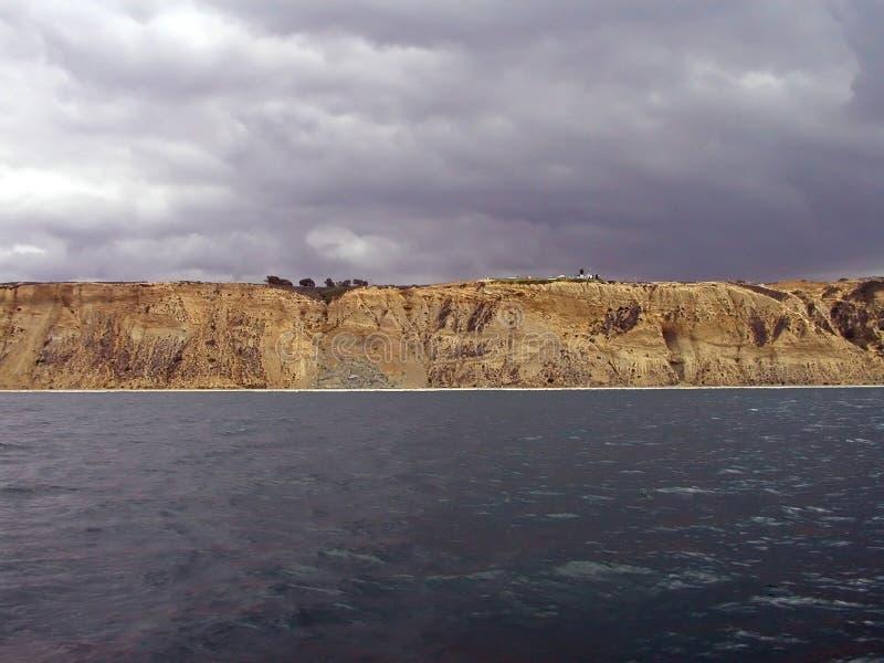 Sandstone cliffs, sky, & ocean royalty free stock photo