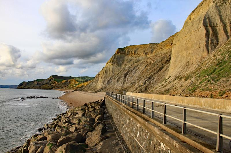 The sandstone cliffs at West Bay in Dorset, England. This is part of the Jurassic coast which runs from Exmouth in Devon to stock photography