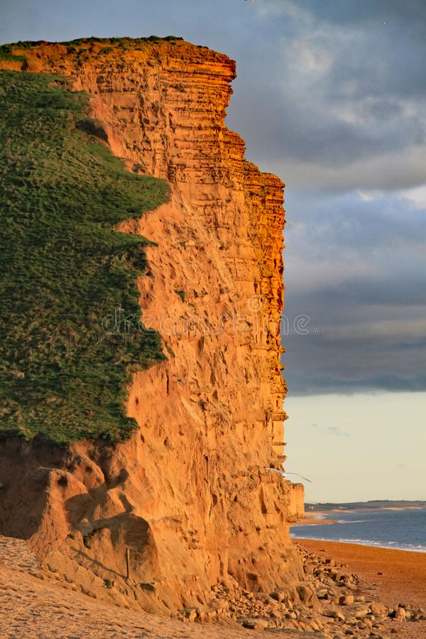 The sandstone cliffs at West Bay in Dorset, England. This is part of the Jurassic coast which runs from Exmouth in Devon to stock photos
