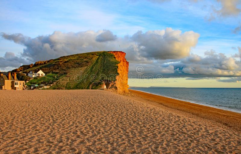 The sandstone cliffs at West Bay in Dorset, England. This is part of the Jurassic coast which runs from Exmouth in Devon to stock image