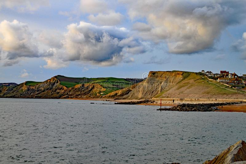 The sandstone cliffs at West Bay in Dorset, England. This is part of the Jurassic coast which runs from Exmouth in Devon to royalty free stock photo