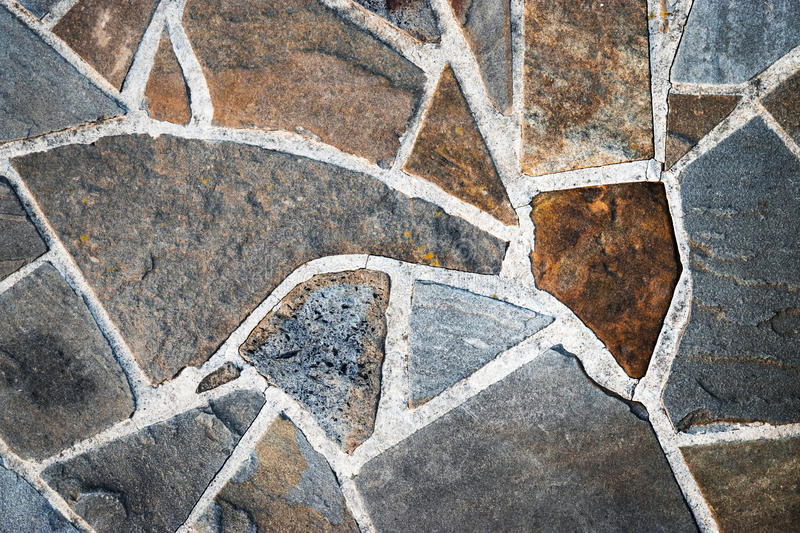 Sandstone paving stone. Background sandstone stone pavement of shapeless of pieces stock photos
