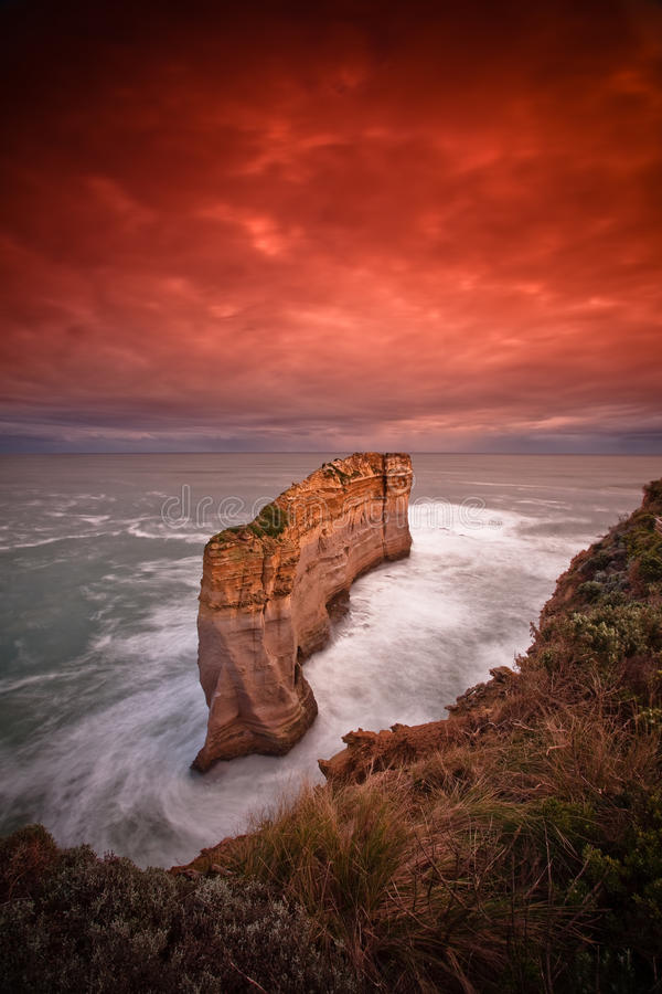 Sandstone pillers sunrise from water at 12 apostle royalty free stock photo