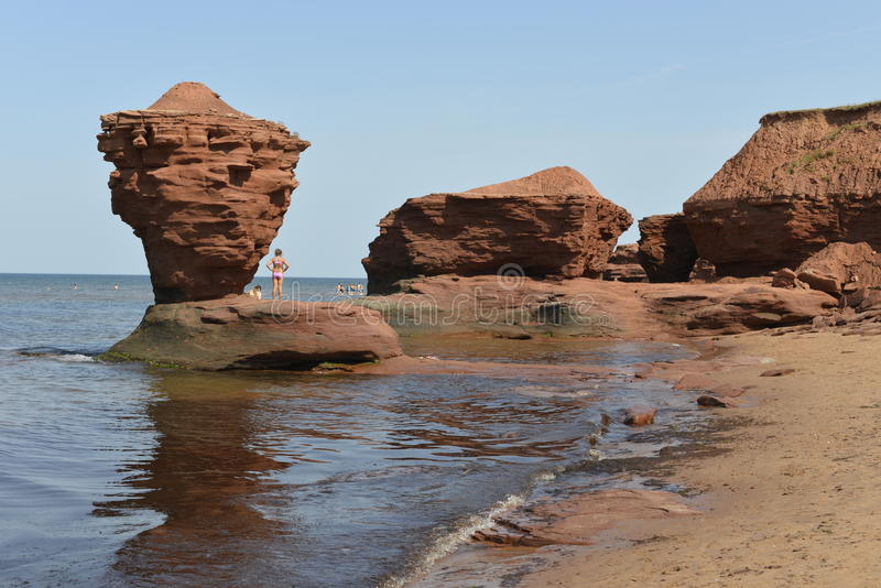 Sandstone Rock formations on a red sand beach royalty free stock images