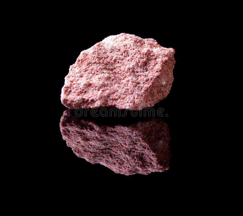 Sandstone rock. Uncut rock piece of sandstone a sedimentary rock composed of sand-sized minerals stock photography