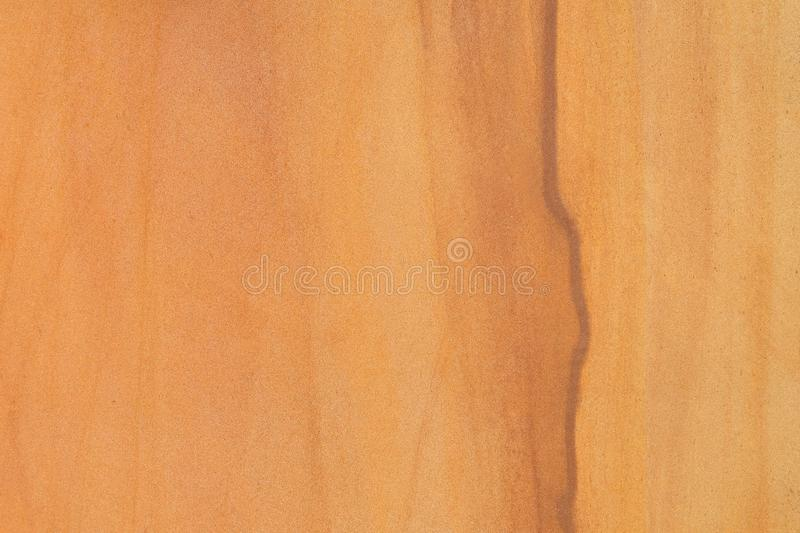 Wooden texture surface from sandstone vanish for design background purpose. Sandstone vanish with the wooden texture like surface for design background royalty free stock images