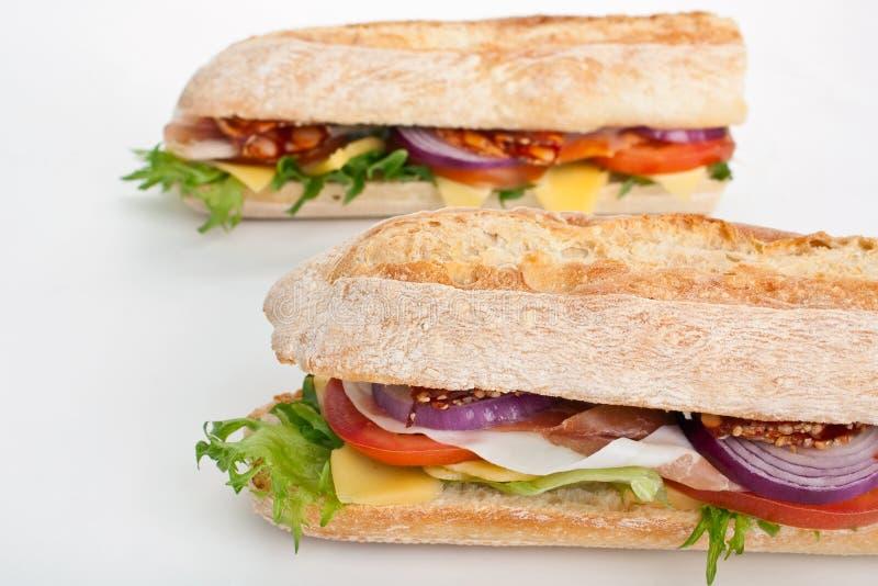 Sanduíche branco do baguette do trigo foto de stock royalty free